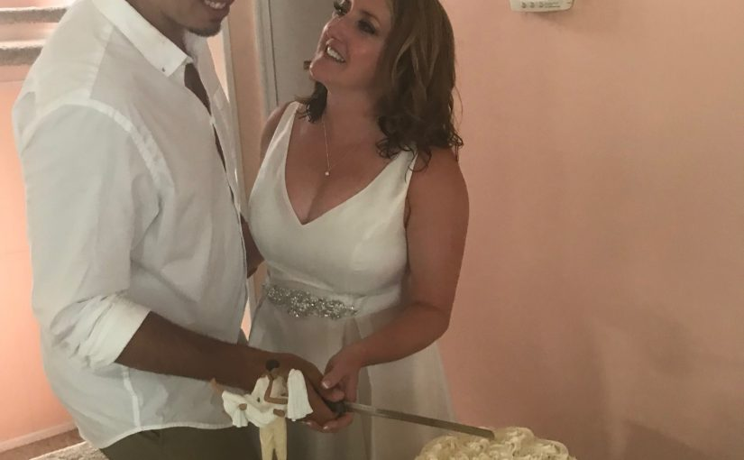 Happily Cutting the cake